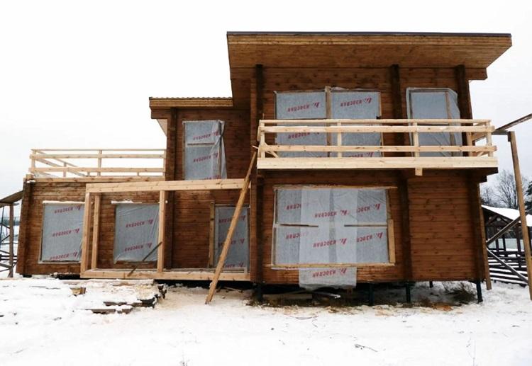 дом из бруса с плоской крышей