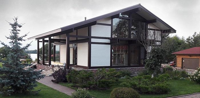 двухэтажный дом в стиле фахверк из клееного бруса